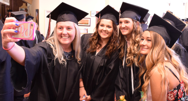 "Dental Assistant students pose for a ""selfie"" at graduation"