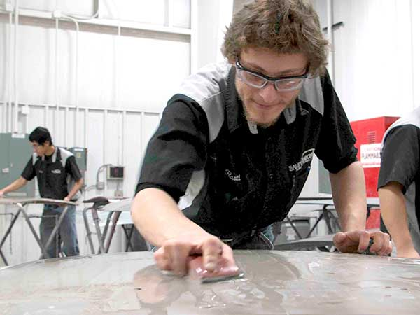 Auto Collision Repair slideshow -- student sanding a body panel