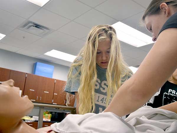 CNA students practice patient care