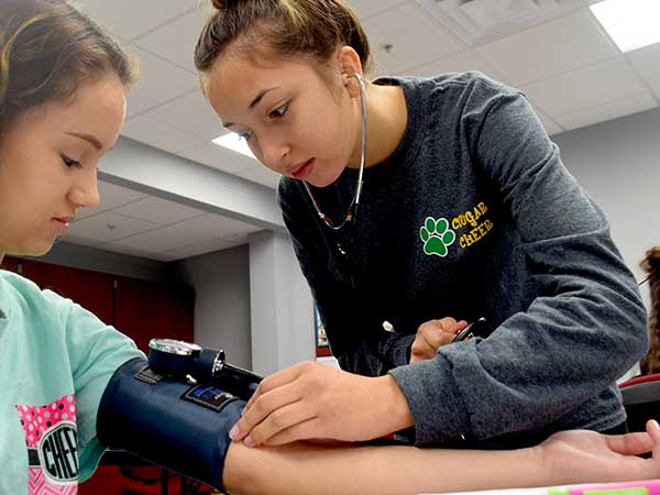 CNA students learn to take blood pressure