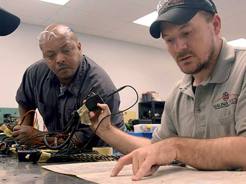 Diesel student and instructor diagnose an electrical problem