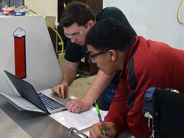 HVAC slideshow -- students using laptop diagnostics