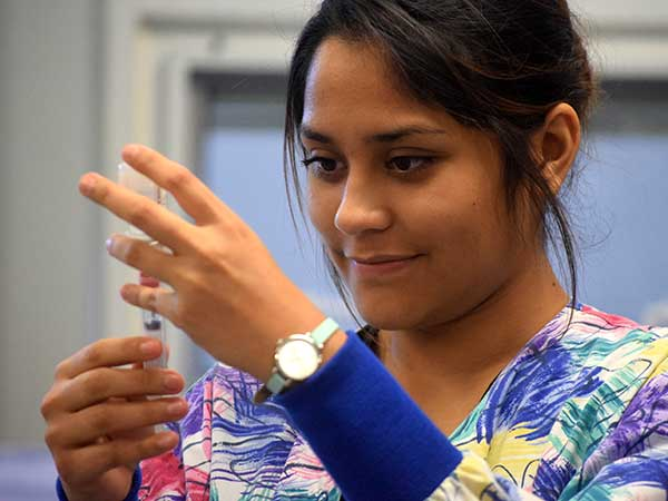 Medical Assistant student prepares an injection