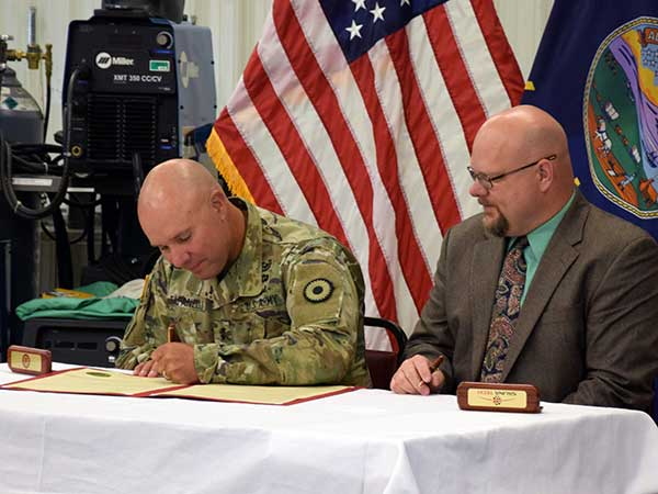 Salina Tech President Greg Nichols and Kansas Adjutant General Lee Tafannelli